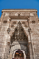 Close up of the Crown Gate of the Buruciye Medrese (Madrasah) built in 1271 by Dr. Muzaffer Burucerdî of Iran as a school teach physics, chemistry and astronomy. Its magnificent crown gate is one of the best examples of Seljuk architecture in Anatolia. The islamic Muqarnas corbelled vault is made up of a large number of miniature squinches, producing a sort of cellular structure. Sivas, Turkey