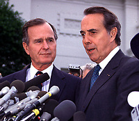 United States President-elect George H.W. Bush and U.S. Senate Minority Leader Bob Dole (Republican of Kansas) meet reporters after their luncheon meeting in the Old Executive Office Building in Washington, DC on November 28, 1988..Credit: Ron Sachs /MediaPunch