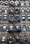 A fire escape on a building on Grand Street, Williamsburg near the East River in Brooklyn, New York.