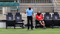 CARY, NC - AUGUST 01: Tommy Soehn gives instructions to his team while Khano Smith watches during a game between Birmingham Legion FC and North Carolina FC at Sahlen's Stadium at WakeMed Soccer Park on August 01, 2020 in Cary, North Carolina.