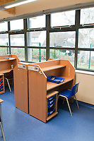 Workstations used in the classroom to help pupils concentrate without being distracted by things around them.  Often used in TEACCH, the Treatment and Education of Autistic and related Communication handicapped Children.