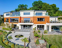 BNPS.co.uk (01202 558833)<br /> Pic: HamptonsInternational/BNPS<br /> <br /> A futuristic 'Hollywood Hills' home which is nestled in the English countryside has emerged on the market for almost £5million.<br /> <br /> Harwin, in Bourne End, Bucks, would not look out of place on the big screen with its striking modern design.<br /> <br /> The five bedroom property which offers stunning views of the Thames Valley has its own cinema, gym and swimming pool.<br /> <br /> It is being sold with estate agent Hamptons International with a guide price of £4.75million.