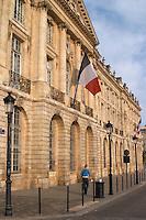 Place de la Bourse. French flag on the facade. Bordeaux city, Aquitaine, Gironde, France