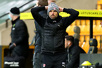 20th February 2021; Carrow Road, Norwich, Norfolk, England, English Football League Championship Football, Norwich versus Rotherham United; Rotherham United Manager Paul Warne holds his head after his side hits the post