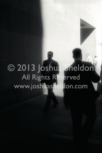 Business men walking on sidewalk<br />