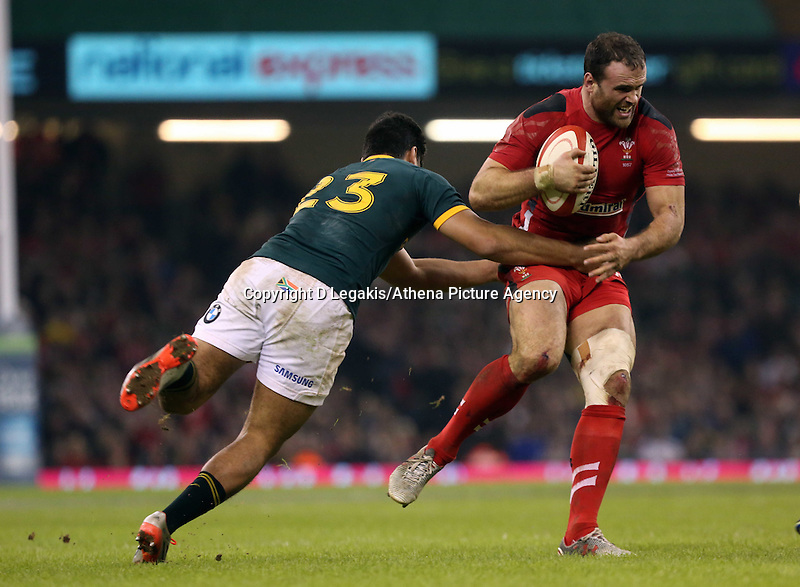 Pictured: Jamie Roberts of Wales is brought down by Damian de Allende away Saturday 29 November 2014<br /> Re: Dove Men Series 2014 rugby, Wales v South Africa at the Millennium Stadium, Cardiff, south Wales, UK.
