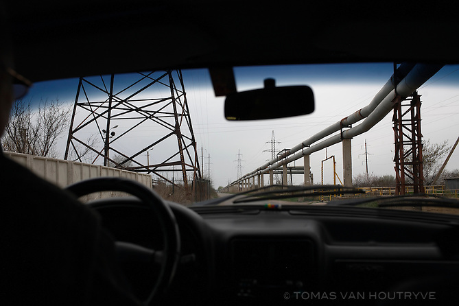 Hot water pipelines and electrical towers are seen through the window of a Russian Volga car in Tiraspol, Transnistria on 10 April 2009.