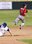 El Paso Diablos Short Stop Maikol Gonzalez (16) and Fort Worth Cats 3rd Baseman Will Calhoun (12) in action during the American Association of Independant Professional Baseball game between the El Paso Diablos and the Fort Worth Cats at the historic LaGrave Baseball Field in Fort Worth, Tx. Fort Worth defeats El Paso 10 to 9.