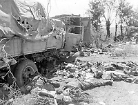 Dead German troops litter an ambushed convoy in Chambois,ca 1944<br /> Author 	<br /> <br /> credited to US National Archives
