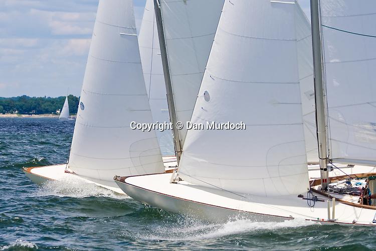Two Atlantic sailboats racing bow to bow