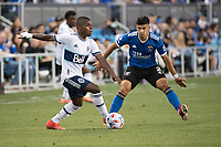 SAN JOSE, CA - AUGUST 13: Deiber Caicedo #7 of the Vancouver Whitecaps  dribbles the ball past Luciano Abecasis #2 of the San Jose Earthquakes during a game between San Jose Earthquakes and Vancouver Whitecaps at PayPal Park on August 13, 2021 in San Jose, California.