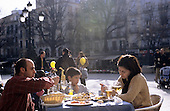 Grenada, Spain. Modern family enjoying lunch in a fashionable restaurant outdoors.