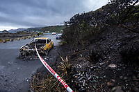 A burnt-out car at Princess Beach during lockdown for the COVID19 pandemic in Wellington, New Zealand on Monday, 27 April 2020. Photo: Dave Lintott / lintottphoto.co.nz