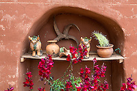 Peru, Urubamba Valley, Quechua Village of Misminay.  Family Altar inside a Residential Compound.  Bulls, or Oxen, are symbols of fertility, protection, and welfare.