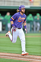 Clemson Tigers designated hitter Reed Rohlman (26) runs to first base during a game against the Notre Dame Fighting Irish at Doug Kingsmore Stadium on March 11, 2017 in Clemson, South Carolina. The Tigers defeated the Fighting Irish 6-5. (Tony Farlow/Four Seam Images)
