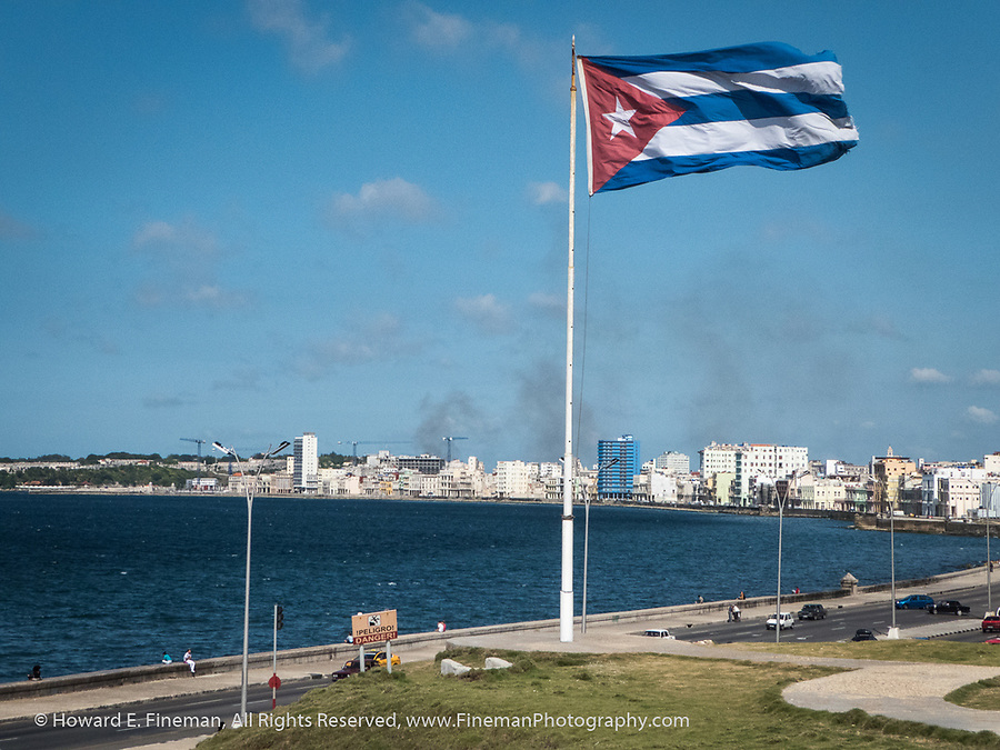 Cuban flag flying proudly above the Malecon, Havana