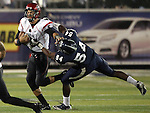 San Diego State's Ryan Katz (5) tries to escape a tackle from Nevada's Jeremiah Green (54) during the first half of an NCAA college football game in Reno, Nev., on Saturday, Oct. 20, 2012. Katz was injured from Green's tackle and was carted off the field.(AP Photo/Cathleen Allison)