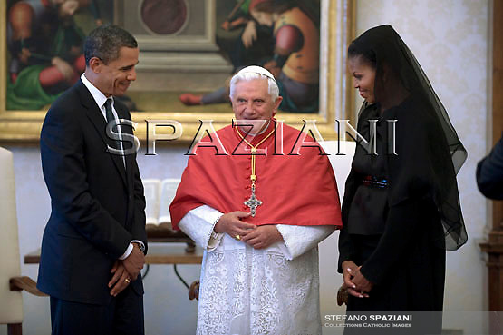 Pope Benedict XVI, during a meeting with U.S. President Barack Obama and first lady Michelle Obama greets Pope in the pontiff's private library at the Vatican .July 10, 2009.
