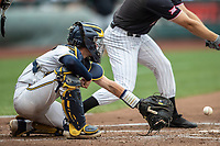 Michigan Wolverines catcher Joe Donovan (0) behind the plate during Game 1 of the NCAA College World Series against the Texas Tech Red Raiders on June 15, 2019 at TD Ameritrade Park in Omaha, Nebraska. Michigan defeated Texas Tech 5-3. (Andrew Woolley/Four Seam Images)