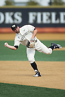 Nate Mondou (10) of the Wake Forest Demon Deacons makes a throw to first base during infield practice prior to the game against the Richmond Spiders at David F. Couch Ballpark on March 6, 2016 in Winston-Salem, North Carolina.  The Demon Deacons defeated the Spiders 17-4.  (Brian Westerholt/Four Seam Images)