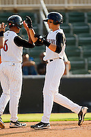 Trayce Thompson #24 of the Kannapolis Intimidators high fives teammate Marcus Semien #6 after hitting a 3-run home run in the bottom of the third inning against the Delmarva Shorebirds at Fieldcrest Cannon Stadium on August 7, 2011 in Kannapolis, North Carolina.  The Intimidators defeated the Shorebirds 8-3.   (Brian Westerholt / Four Seam Images)