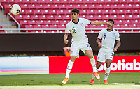 ZAPOPAN, MEXICO - MARCH 21: Johnny Cardoso #16 of the United States heads a ball during a game between Dominican Republic and USMNT U-23 at Estadio Akron on March 21, 2021 in Zapopan, Mexico.