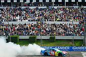 #18: Kyle Busch, Joe Gibbs Racing, Toyota Camry M&M's Hazelnut celebrates with a burnout after winning