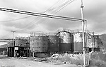 Lawrenceville PA: Location photography at the Atlantic Refining site at 5733 Butler Street. View of workman moving a barrel of oil next to storage tanks.<br /> This track of land has been involved in oil-related refining for over 100 years.  ARCO sold the property to SUNOCO which still operates a storage facility at 5733 Butler Street.