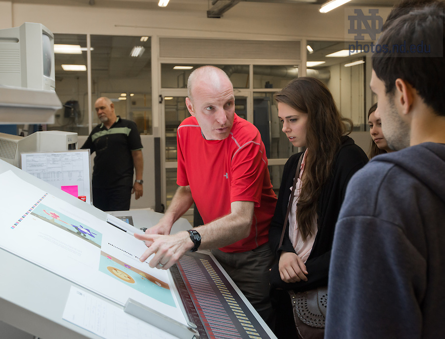 Mar. 12, 2013; Design professor Robert Sedlack takes his design students to a press check for a student-designed children's book on xenophobia.  Sedlack led a group of design students to South Africa to do in-person research on design projects aimed at addressing several issues affecting South Africa and Johannesburg.<br /> <br /> Photo by Matt Cashore/University of Notre Dame
