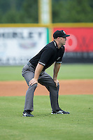 Umpire Mark Stewart handles the calls on the bases during the Appalachian League game between the Bluefield Blue Jays and the Burlington Royals at Burlington Athletic Stadium on June 27, 2016 in Burlington, North Carolina.  The Royals defeated the Blue Jays 9-4.  (Brian Westerholt/Four Seam Images)