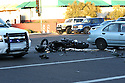 AJ ALEXANDER/AJA - A Fatal Motorcycle vs Car on Greenway and 40th St, Phoenix, AZ on or about 5 pm, still light and a clear evening on Wed, December 26, 2012.  The motorcycle driver was wearing a helmet traveling eastbound on the intercection of Greenway and 40th St. while the Car driver was traveling west bound and making a left hand turn south bound impacting on the eastbound lane at the intercection.Photo by AJ ALEXANDER (c)