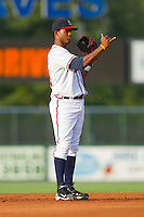 Shortstop Edward Salcedo #15 of the Rome Braves on defense against the Greenville Drive at State Mutual Stadium July 24, 2010, in Rome, Georgia.  Photo by Brian Westerholt / Four Seam Images