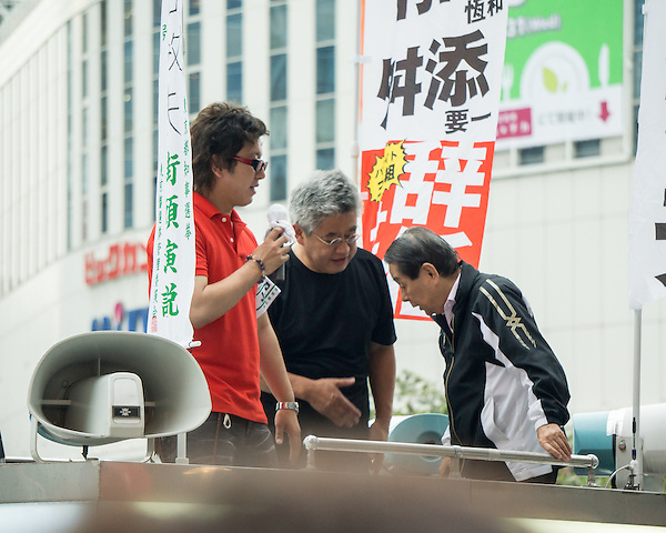 Speakers of one of a political meetings near the West Exit of Shinjuku. They finish talking with traditional thank you bow.