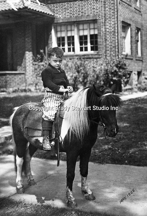 Wilkinsburg PA:  A birthday present for Brady W Stewart Jr; a pony ride outside his house. Brady Stewart's family moved to 1007 East End Avenue in Wilkinsburg in 1925.
