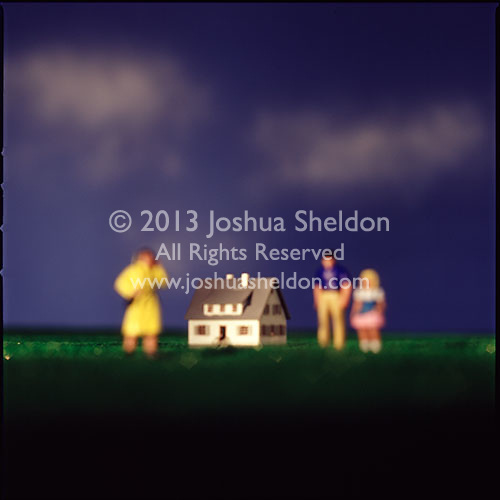 Miniature family in front of house<br />