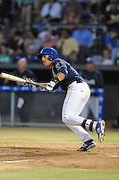Asheville Tourists catcher Jose Briceno #4 swings at a pitch during opening night game against the Delmarva Shorebirds at McCormick Field on April 3, 2014 in Asheville, North Carolina. The Tourists defeated the Shorebirds 8-3. (Tony Farlow/Four Seam Images)