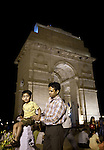 June 21 2012, New Delhi, India:  A visitor and his son posing at India Gate, the national monument of India. Situated in the heart of New Delhi, India Gate was designed by Sir Edwin Lutyens. Originally known as All India War Memorial, it is a prominent landmark in Delhi and commemorates the 90,000 soldiers of the British Indian Army who lost their lives while fighting for the British Indian Empire, or more correctly the British Empire in India British Raj in World War I and the Third Anglo-Afghan War. It is composed of red sand stone and granite.        Picture by Graham Crouch/Holland Herald