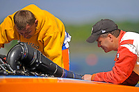 """Sean Bowsher Y-52 works on his boat as rival Dan Kanfoush, Y-1 """"Fast Eddie Too"""" looks on and offers unwanted advice.  (1 Litre MOD hydroplane(s)"""
