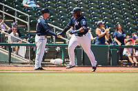 Northwest Arkansas Naturals catcher Xavier Fernandez (34) is congratulated by manager Darryl Kennedy (8) while rounding third after hitting a home run on May 19, 2019, at Arvest Ballpark in Springdale, Arkansas. (Jason Ivester/Four Seam Images)