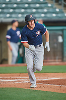 Eric Campbell (36) of the Tacoma Rainiers heads to first base against the Salt Lake Bees at Smith's Ballpark on May 16, 2021 in Salt Lake City, Utah. The Bees defeated the Rainiers 8-7. (Stephen Smith/Four Seam Images)