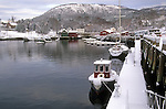 Small tugboat covered with snow in the harbor in Camden, Maine, USA
