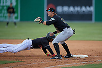 West Virginia Black Bears first baseman Nick Patten (16) waits for a pickoff attempt throw as Dalvy Rosario (17) dives back tot he bag during a NY-Penn League game against the Batavia Muckdogs on June 25, 2019 at Dwyer Stadium in Batavia, New York.  Batavia defeated West Virginia 7-3.  (Mike Janes/Four Seam Images)