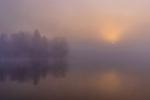 Foggy sunrise on Blaisdell Lake in northern Wisconsin.