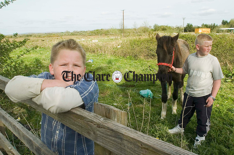 Connie O Donoghue and Shane O Donoghue with their pony at Gort. Photograph by John Kelly.