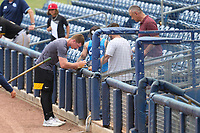 FCL Pirates Black Henry Davis (32) signs autographs after a game against the FCL Rays on August 3, 2021 at Charlotte Sports Park in Port Charlotte, Florida.  Davis was making his professional debut after being selected first overall in the MLB Draft out of Louisville by the Pittsburgh Pirates.  (Mike Janes/Four Seam Images)