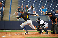 Bradenton Marauders left fielder Alfredo Reyes (13) follows through on a swing in front of catcher Sharif Othman (62) and home plate umpire Greg Roemer during the first game of a doubleheader against the Tampa Yankees on April 13, 2017 at George M. Steinbrenner Field in Tampa, Florida.  Bradenton defeated Tampa 4-1.  (Mike Janes/Four Seam Images)