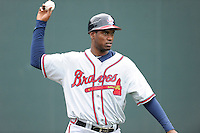 Catcher Anthony Nunez (58) of the Rome Braves warms up before a game against the Greenville Drive on Thursday, July 31, 2014, at Fluor Field at the West End in Greenville, South Carolina. Rome won the rain-shortened game, 4-1. (Tom Priddy/Four Seam Images)