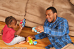 17 month old toddler boy playing with his father and toy vehicles