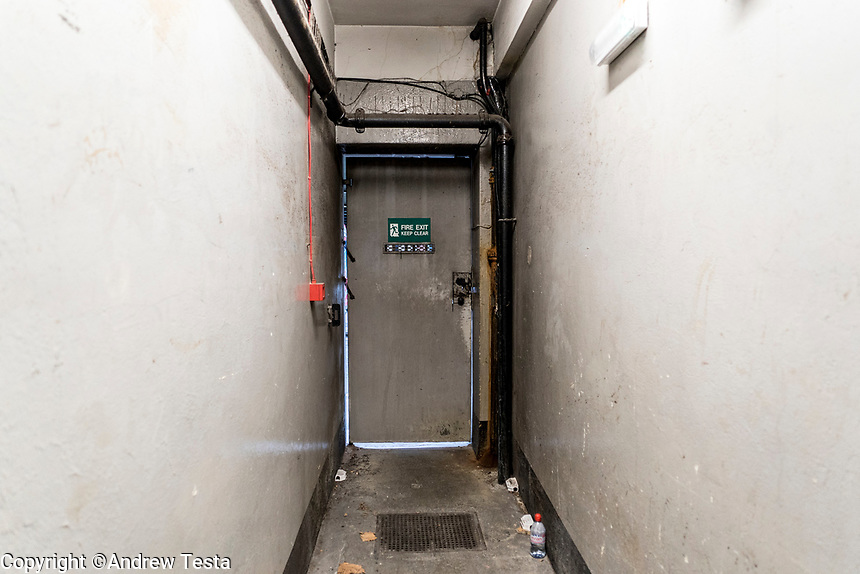 UK. London. 4th December 2015<br /> A side entrance to the building that houses the Hatton Garden Safe Deposit Ltd. <br /> Andrew Testa for the New York Times<br /> <br /> NOTE: No one stopped us from entering the building where these photos were taken, but whilst we were there someone came, threatened to call the police and said that we were forbidden to take photographs, not sure where that leaves us legally re publishing these photos.
