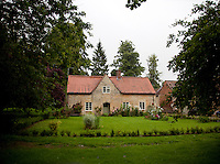 A quaint estate cottage and garden in the grounds of Hackthorn Hall